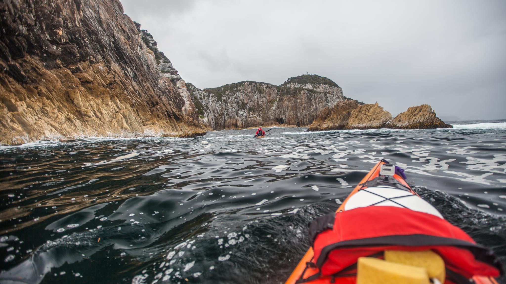 Kayaking outside Breaksea Island Port Davey Southwest Tasmania