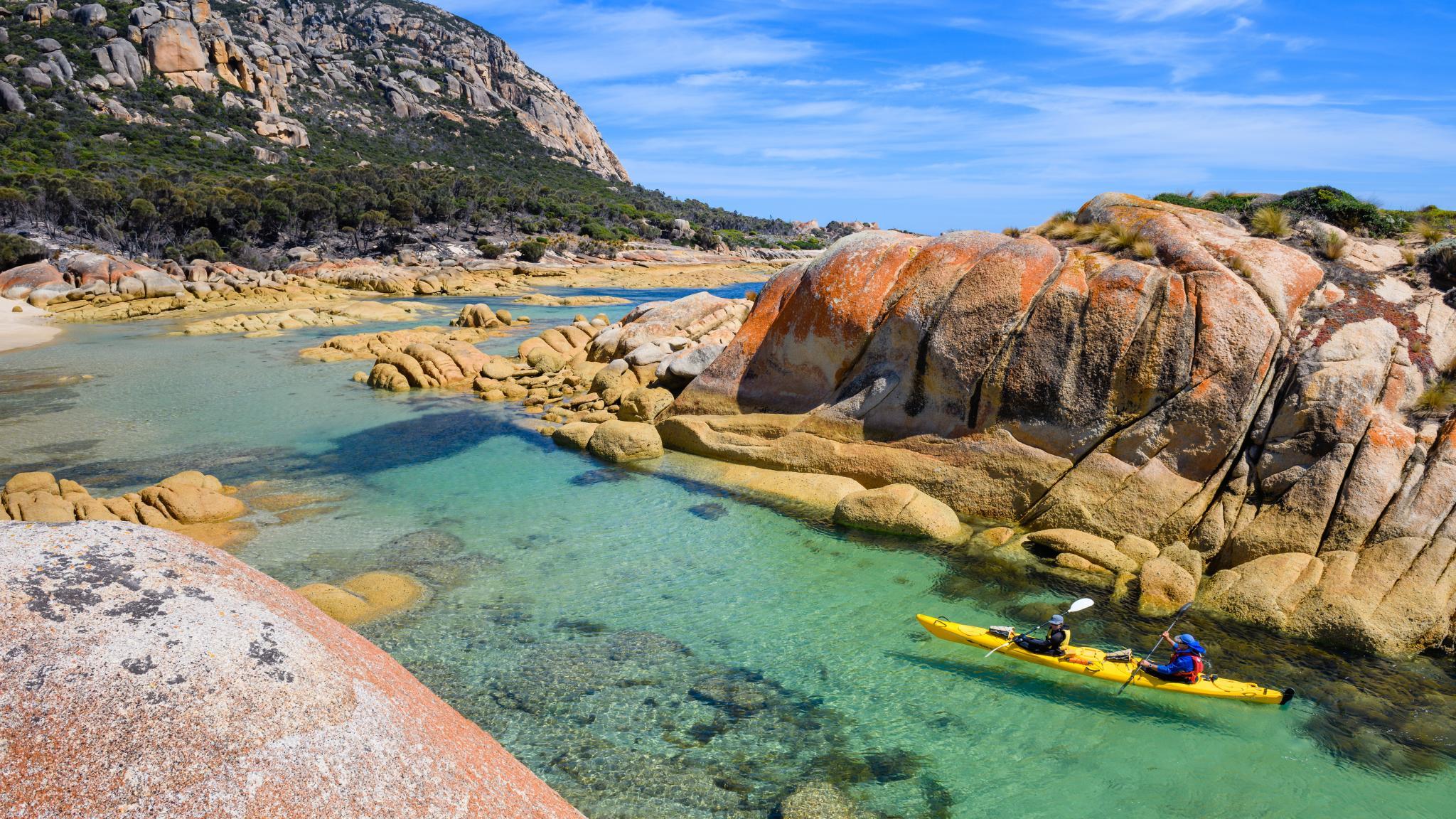 Roaring 40s Kayaking - Kayakers on a multi day tour on Flinders Island Tasmania