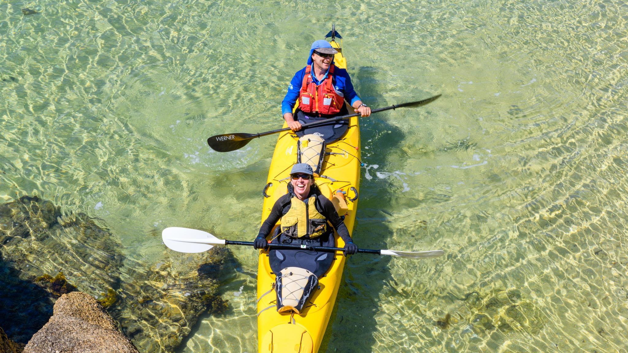 Kayakers on clear water on Flinders Island